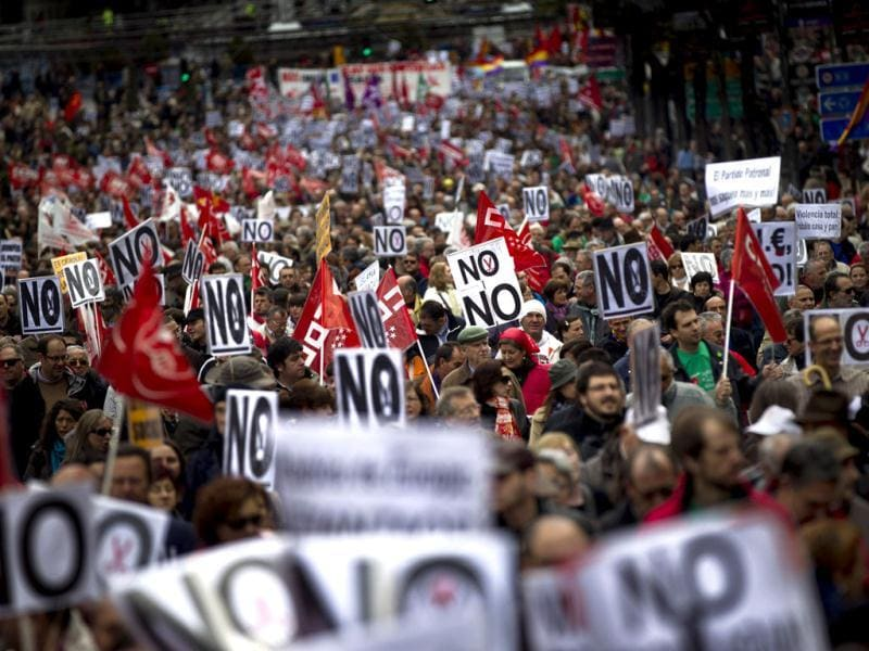 Thousands demonstrate against education and health care spending cuts in Madrid. Tens of thousands of people across Spain are protesting education and health care spending cuts as the country slides into its second recession in three years. (AP Photo)