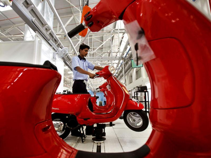 A worker works on Vespa scooters at its manufacturing unit in Baramati some 150 kilometers from Pune. The Italian company hopes to carve out a market for luxury scooters in one of the most cost-conscious markets in the world. (AP Photo)
