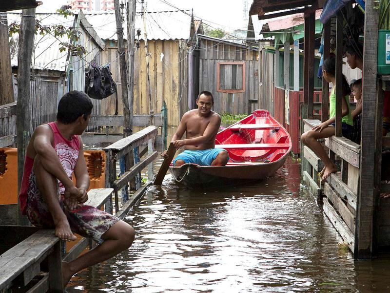 A man travels by a canoe through floodwaters in a canal branching off the Negro River on the Gloria neighborhood in Manaus, northern Brazil. The city of Manaus declared a state of emergency due to river flooding in the city, which is estimated to affect more than 3,600 families if the water levels continue to rise, according to the Civil Defense. (Reuters)