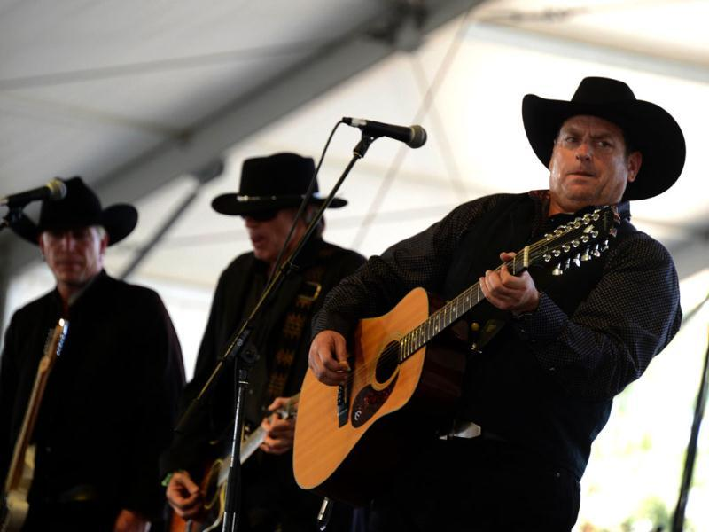 "The Unforgiven, with lead singer Steve ""John Henry"" Jones (R), performs on stage at the Stagecoach Country Music Festival at The Empire Polo Club in Indio, California. AFP Photo/Robyn Beck"