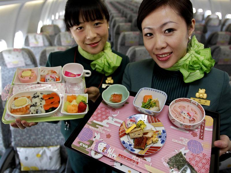Flight attendants, holding Hello Kitty-themed in-flight meals, pose inside an Eva Airlines aircraft in Taoyuan International Airport, northern Taiwan. Reuters photo/Pichi Chuang