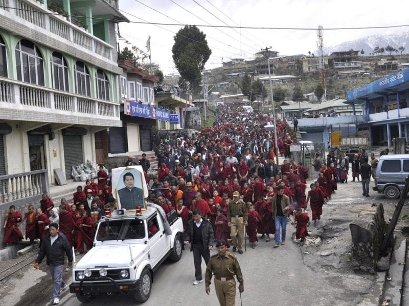 People of Tawang town along with monks of various monasteries carry out a homage march for former Arunachal Pradesh chief minister Dorjee Khandu who died in a chopper crash on April 30 last year. HT Photo