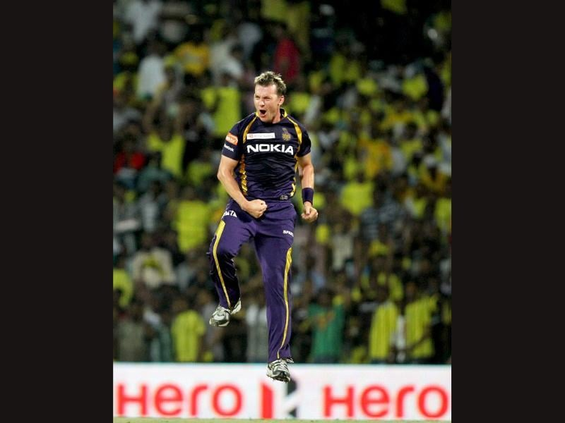 Kolkata Knight Riders' Brett Lee celebrates the wicket of Chennai Super Kings opener Michael Hussey during their IPL5 match in Chennai. PTI/R Senthil Kumar