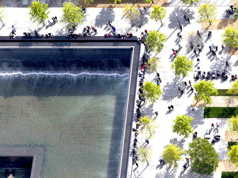 Attendees of the 9/11 Memorial are seen from the 90th story of One World Trade Center in New York. The addition of iron columns to the 100th story pushed the height of One World Trade above that of the Empire State Building. (Reuters/Lucas Jackson)
