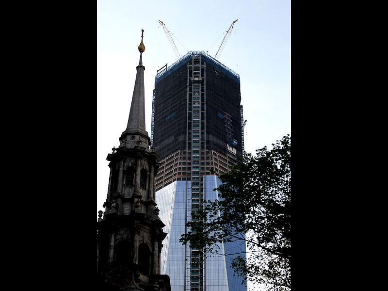 St. Paul's Chapel's steeple is seen as construction continues on One World Trade Center after workers moved a steel column into place to make it New York City's tallest building in New York City. (Mario Tama/Getty Images/AFP)
