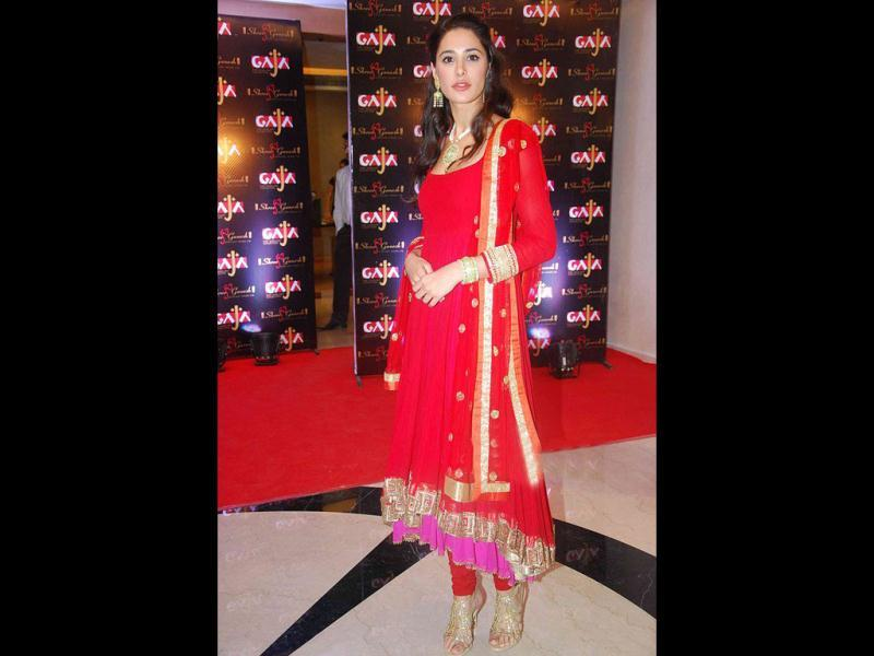 Nargis Fakhri is clad in a red asymmetrical anarkali.