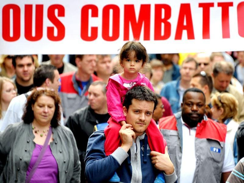 People take part in a march as part of the annual May Day workers' events on May 1, 2012 in Strasbourg, eastern France.