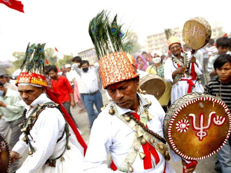 Maoist activists and supporters, wearing traditional attire, play traditional instruments as they arrive during a rally to commemorate Labour Day in Kathmandu May 1, 2012. (Reuters)