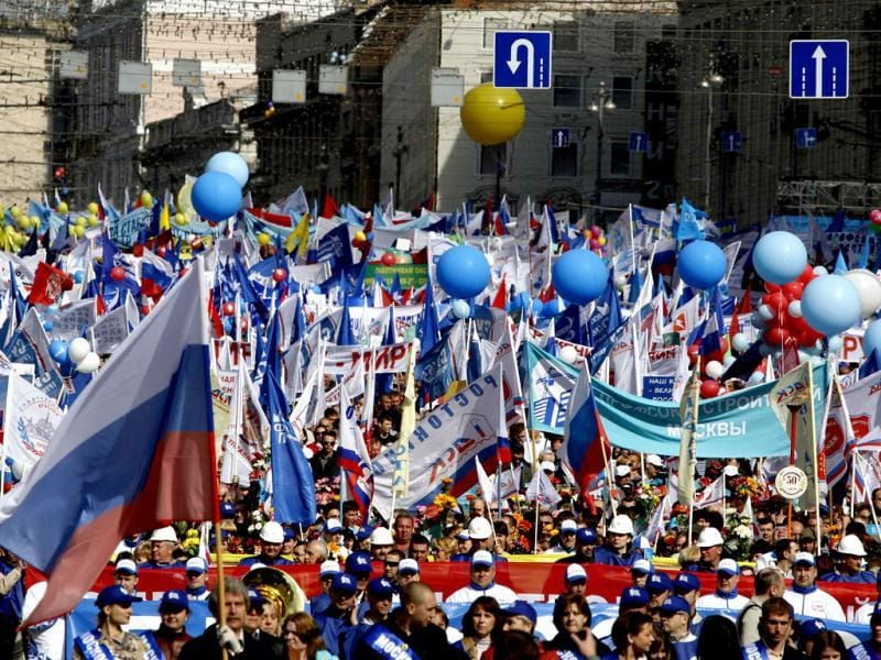 Participants march and wave flags during a rally organised by the Russian Federation of Trade Unions to celebrate International Workers' Day, or Labour Day, in Moscow.