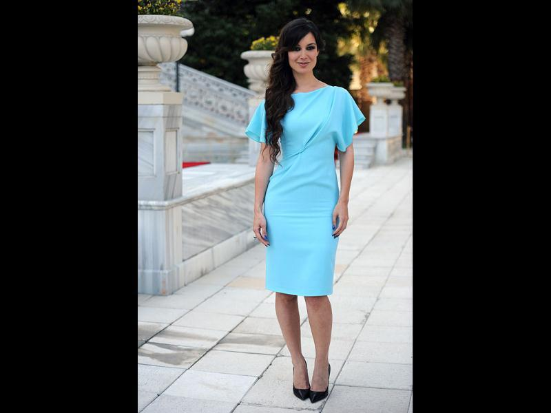 Berenice Marlohe looks chic in a summery sky blue dress.