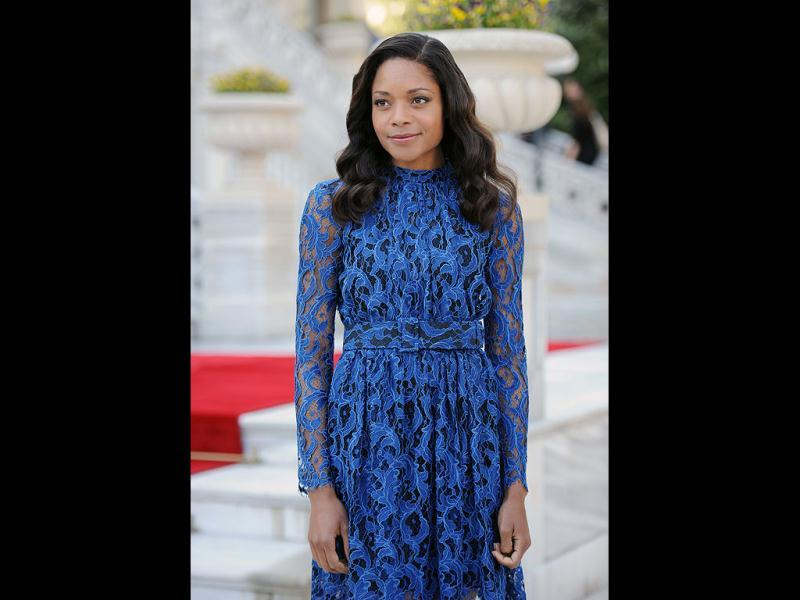 Actor Naomie Harris poses in a blue lace dress.