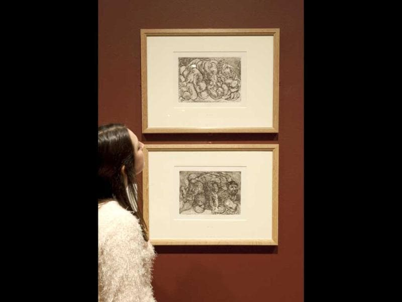 A person looks at two etchings, drypoint, aquatint and scrapers entitled