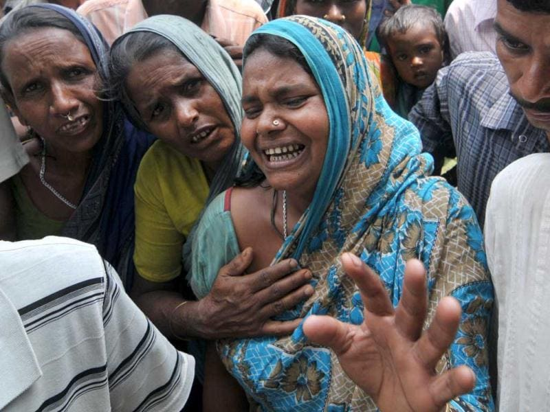 A relative of a victim of ferry disaster mourns near Bura-Buri village in Goalpara district of Assam. Police said 105 corpses, including many women and children, had been recovered so far. AFP/Biju Boro