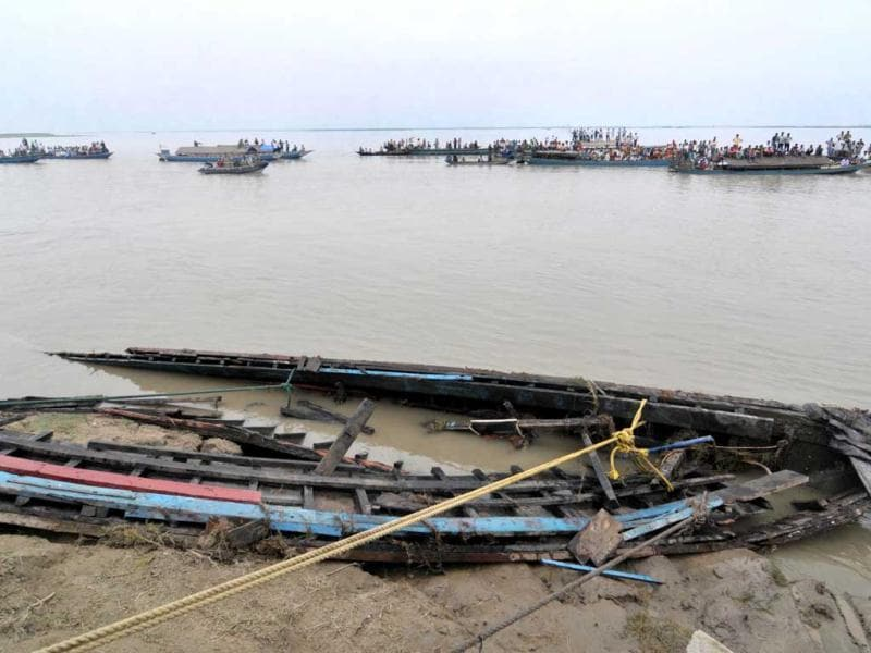 Pieces of a sunken ferry are washed up on the bank of the river Brahmaputra near Bura-Buri village in Goalpara district of Assam. Police said 105 corpses, including many women and children, had been recovered so far from the fast-flowing Brahmaputra river in Assam, where the ferry was split in two during a sudden storm. AFP/Biju Boro
