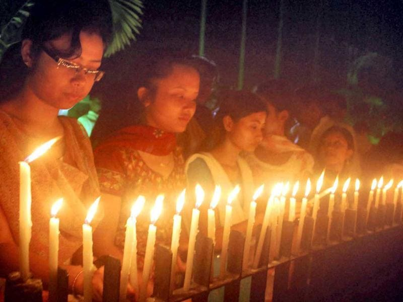 Members of National Students Union of India and Assam Pradesh Youth Congress jointly observe a candle vigil for the victims of the ferry disaster in the Brahmaputra river, in Guwahati. PTI Photo