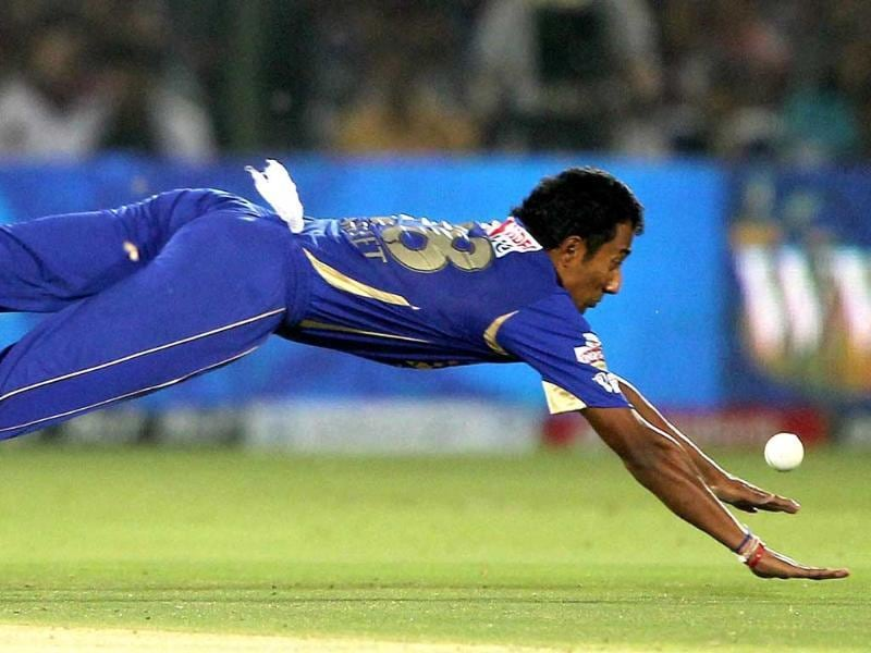 Rajasthan Royals' Ankeet Chavan dives to stop the ball against Delhi Daredevils during their IPL-5 match in Jaipur. PTI/Aman Sharma