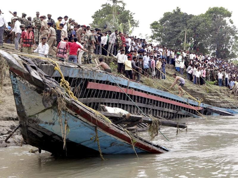 Rescuers pull out the wreckage of a ferry that capsized in the Brahmaputra River at Buraburi village, about 350 kilometers (215 miles) west of Guwahati, India. AP Photo/Anupam Nath