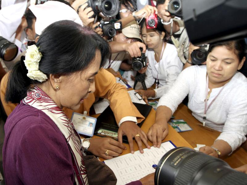 Myanmar pro-democracy icon Aung San Suu Kyi, registers on attendee's book as she attends a regular session of Myanmar Lower House at parliament in Naypyitaw, Myanmar. AP Photo/Khin Maung Win