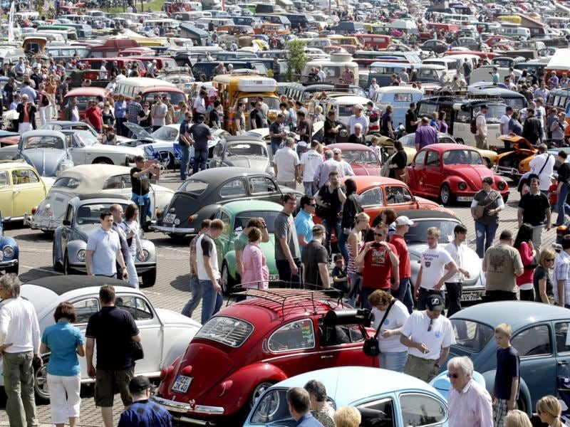 People look at vintage Volkswagen cars during the 29th annual