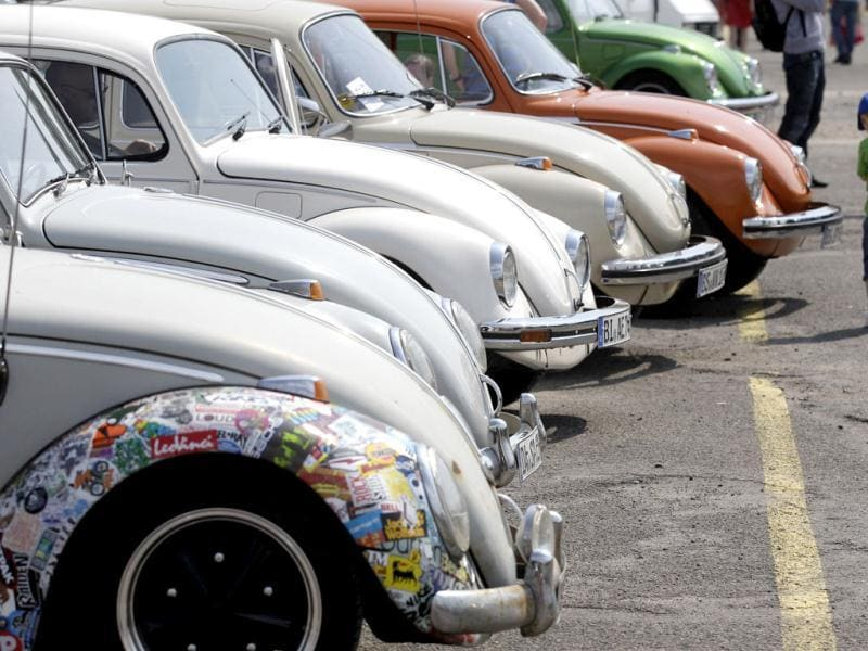 A child passes a row of Beetle cars during the 29th annual