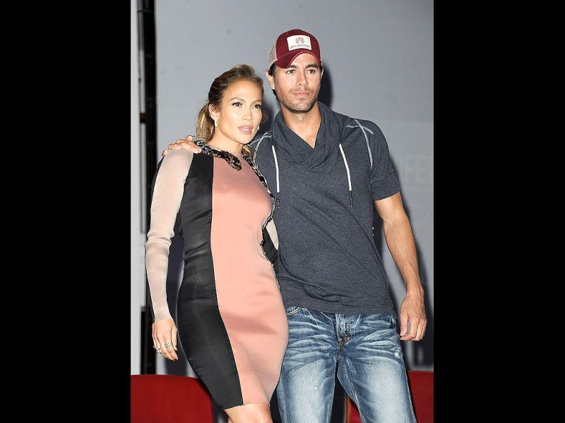 Jennifer Lopez and Enrique Iglesias pose for the cameras during the news conference to announce their summer tour.