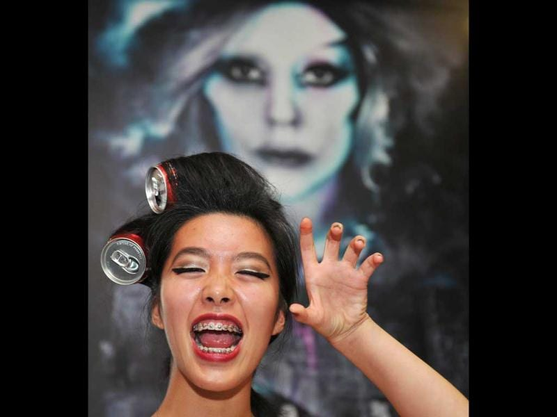 A fan of US pop diva Lady Gaga strikes a pose before her concert in Hong Kong. AFP Photo/Laurent Fievet