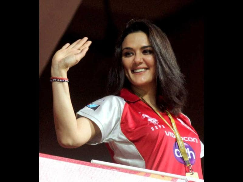 Kings Eleven Punjab co -owner Preity Zinta waves to her fans during the IPL 5 match against Royal Challengers Bangalore in Bengaluru. PTI Photo/Shailendra Bhojak