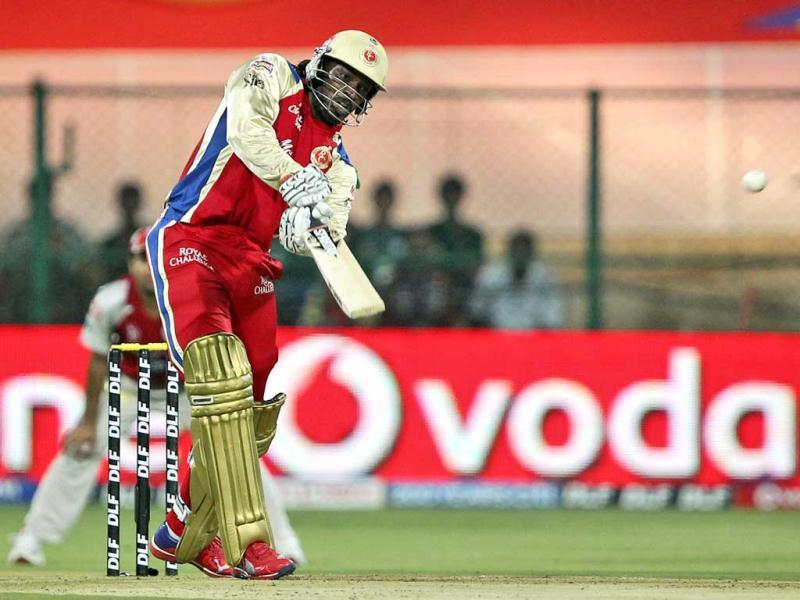Royal Challengers Bangalore's Chris Gayle plays a shot during the Indian Premier League (IPL) cricket match against Kings XI Punjab in Bangalore. AP Photo