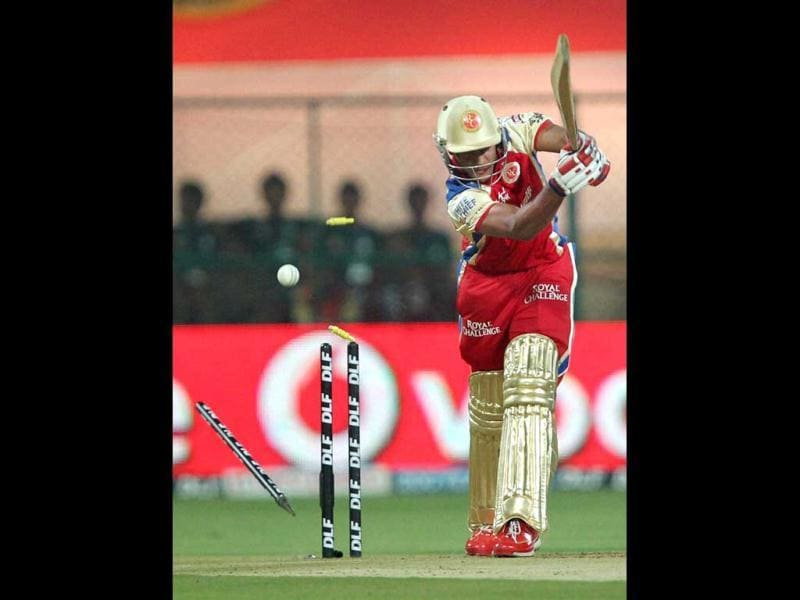 Royal Challengers Bangalore Mayank Agarwal gets clean bowled during the IPL 5 match against Kings Eleven Punjab in Bengaluru. PTI Photo by/Shailendra Bhojak