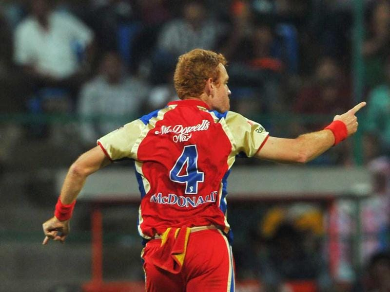 Royal Challengers Bangalore bowler Andrew McDonald celebrates taking the wicket of Kings XI Punjab batsman Shaun Marsh (unseen) during the IPL Twenty20 cricket match between Royal Challenger Bangalore and Kings XI Punjab at the M. Chinnaswamy Stadium in Bangalore. AFP Photo/Manjunath Kiran