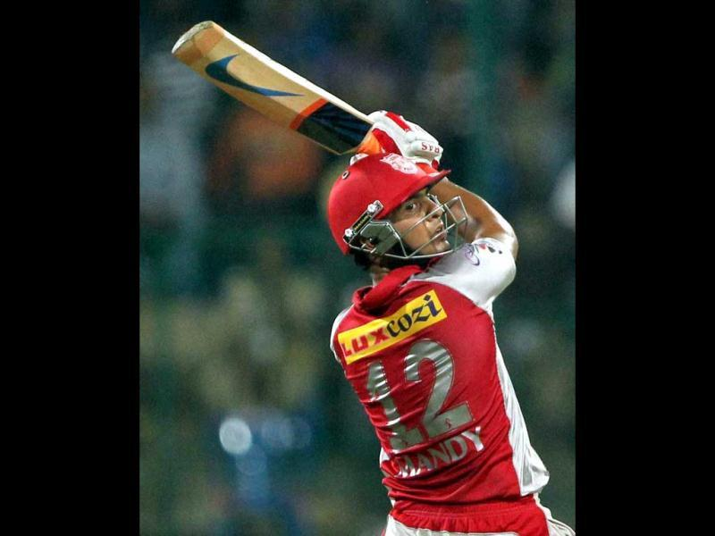 Kings XI Punjab Mandeep Singh plays a shot during the IPL 5 match against Royal Challengers Bangalore in Bengaluru. PTI Photo/Shailendra Bhojak