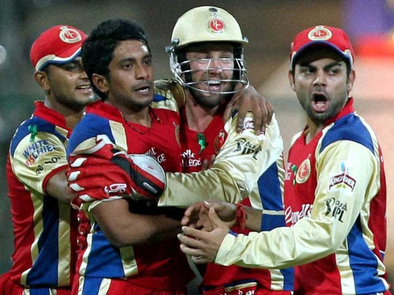 Royal Challengers Bangalore KP Appanna celebrates with team mates the wicket of Kings XI Punjab Mandeep Singh during the IPL 5 match in Bengaluru. PTI Photo/Shailendra Bhojak