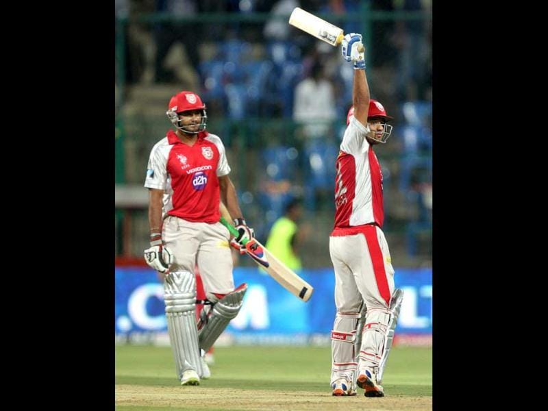 Kings XI Punjab Piyush Chawla and P Dogra celebrate their team's win over Royal Challengers Bangalore during the IPL 5 match in Bengaluru. PTI Photo/Shailendra Bhojak