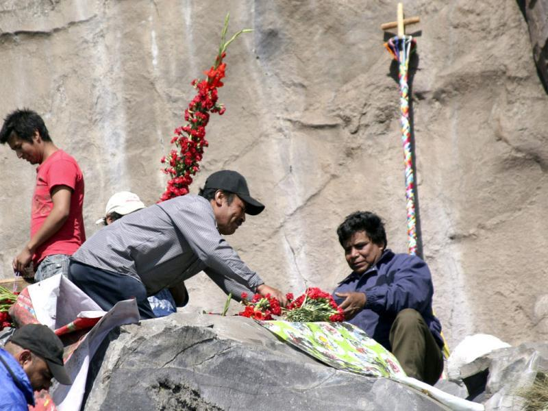 Pilgrims from the town of Santiago Xalizintla leave flowers at the foot of the Popocatepetl as others pray at a shrine on the slopes of the volcano, on the outskirts of Puebla. Reuters/Stringer