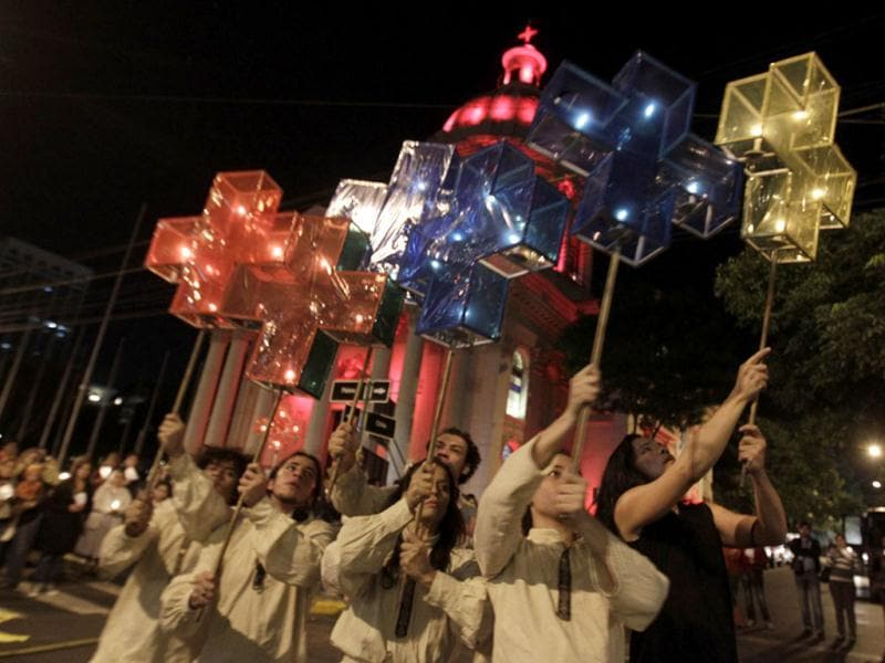 Actors from the group Hara perform in front of the National Pantheon of The Heroes before a procession on the eve of Kurusu Ara, or the Day of the Cross, in Asuncion. Reuters/Jorge Adorno