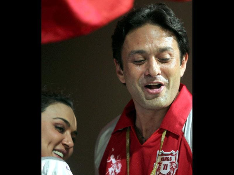 Ex flames Ness Wadia and Preity Zinta celebrate their team's win over Royal Challengers Bangalore during the IPL 5 match. (PTI)