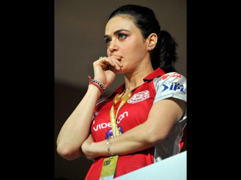 Preity Zinta spends tense moments watching her team play during the IPL Twenty20 cricket match between Royal Challenger Bangalore and Kings XI Punjab at the M. Chinnaswamy Stadium in Bangalore
