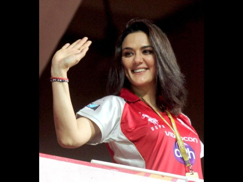 Preity Zinta waves at her fans during the IPL 5 match against Royal Challengers Bangalore in Bengaluru.