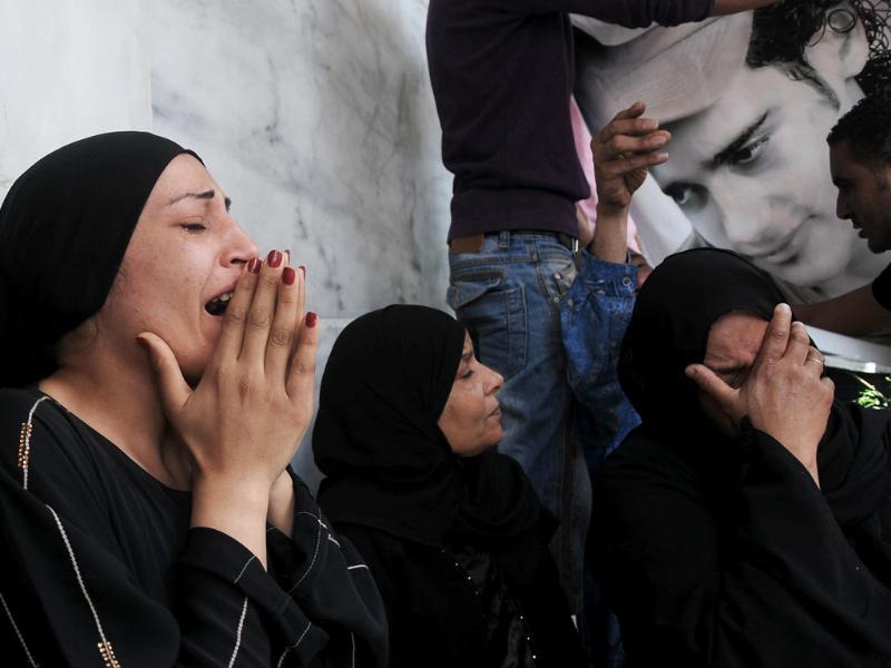 Egyptian women mourn over the death of victims of clashes outside the Defense Ministry in Cairo, Egypt. Suspected supporters of Egypt's military rulers attacked predominantly Islamist anti-government protesters outside the Defense Ministry in Cairo, setting off clashes that left more than ten people dead as political tensions rise three weeks before crucial presidential elections. (AP Photo/Mohammed Asad)