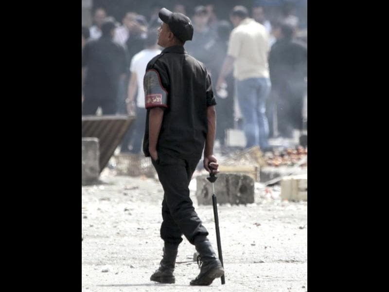 Egyptian riot police takes his position as they separate anti-military protesters and armed