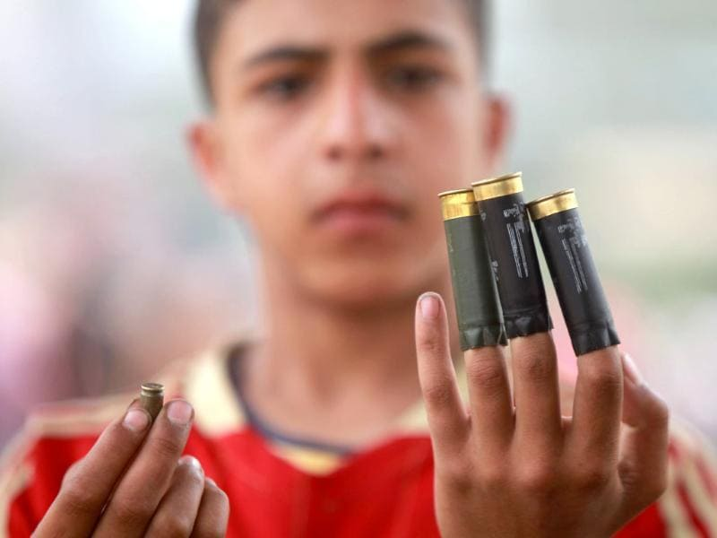 An Egyptian anti-military protester shows spent bullet casings during clashes in the Abbassiya district of Cairo. Thugs attacked an anti-military protest near the defence ministry in Cairo and at least 20 people were killed, officials said, in the politically tense run-up to the first post-uprising presidential election. AFP PHOTO/KHALED DESOUKI