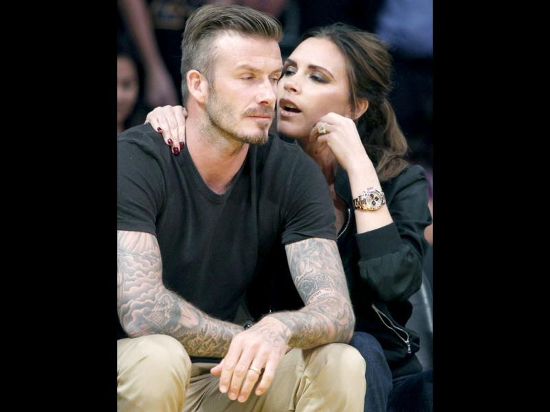 The 38-year-old could be seen whispering to her sports star husband, rather than watching the action on court.