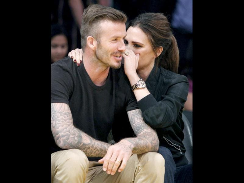 After the celebrity couple was singled out by the KissCam, they sportingly kissed for the crowd.
