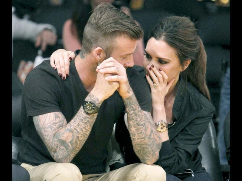 David Beckham and his wife Victoria were seen enjoying a day away from kids at a basketball game between the Los Angeles Lakers and the Denver Nuggets in LA.