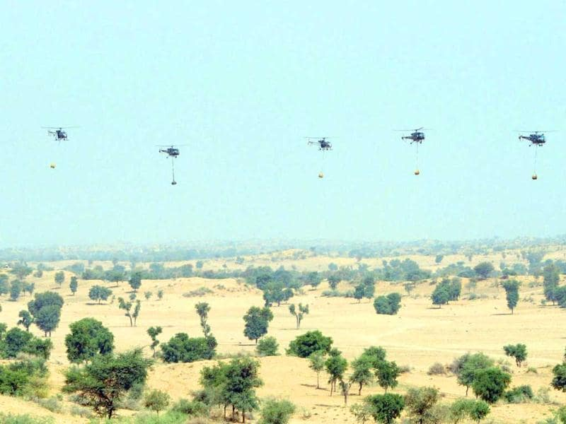 Indian Army Chetak and Cheetah helicopters transport equipment during the Shoor Veer military exercise. AFP/Sam Panthaky
