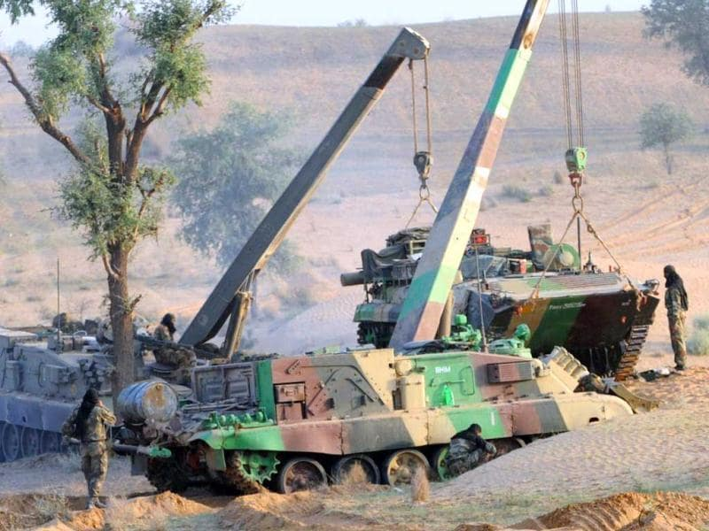 An Indian Army armoured personnel carrier is lifted by cranes before maneuvers during the Shoor Veer military exercise. AFP/Sam Panthaky