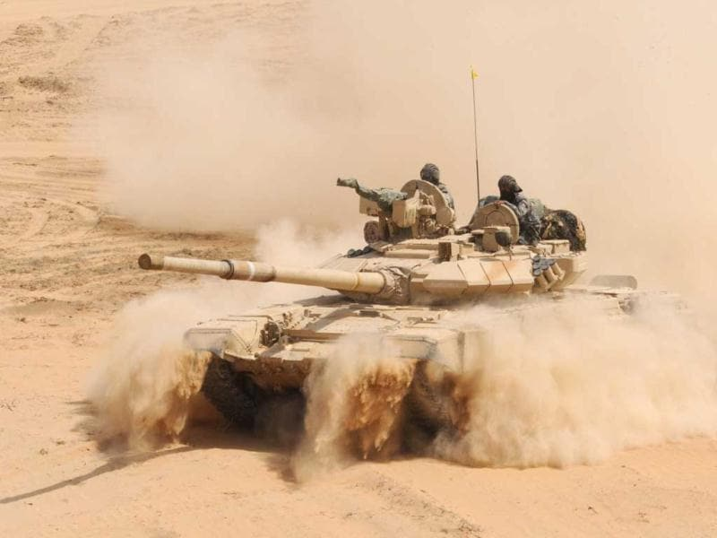 An Indian Army T-90 battle tank kicks up dust during the Shoor Veer military exercise. AFP/Sam Panthaky