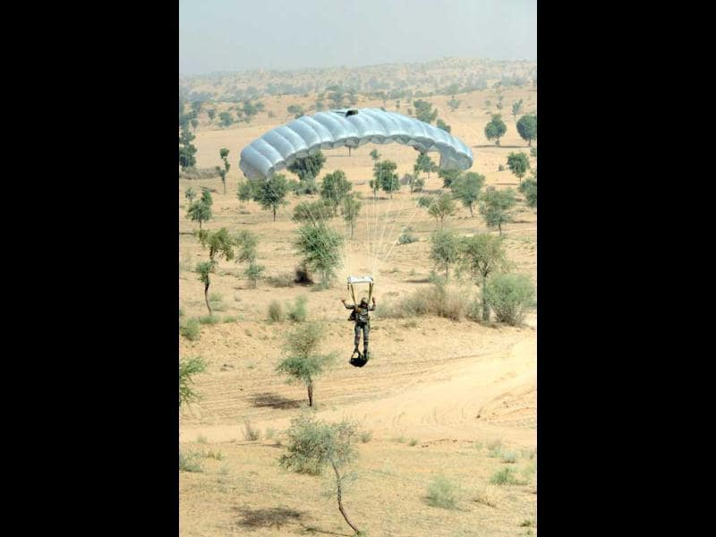 A paratrooper prepares for landing after a jump during the Shoor Veer military exercise. AFP/Sam Panthaky