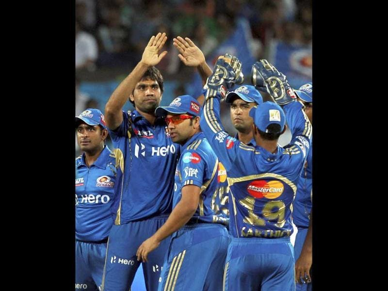 Mumbai Indians celebrate the dismissal of Robin Uthappa during IPL 5 match against Pune Warriors in Pune. PTI Photo/Shirish Shete