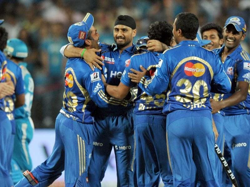 Mumbai Indians' cricketers celebrate their victory over Pune Warriors India at the end of the IPL 5 cricket match between Pune Warriors India and Mumbai Indians in Pune. AFP Photo/Indranil Mukherjee